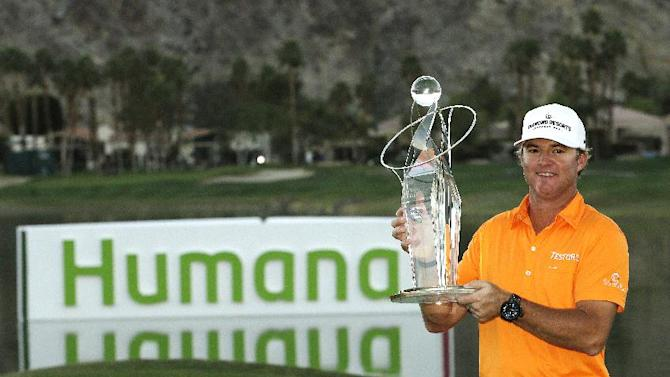 Brian Gay poses with the trophy after winning the Humana Challenge PGA golf tournament on the Palmer Private Course at PGA West, Sunday, Jan. 20, 2013, in La Quinta, Calif. (AP Photo/Ben Margot)
