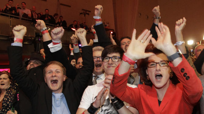Social Democratic Party members react after the first results were published in Duesseldorf, Germany, Sunday May 13, 2012. Germany's most populated and industrial state holds parliament elections on Sunday. (AP Photo/Frank Augstein)