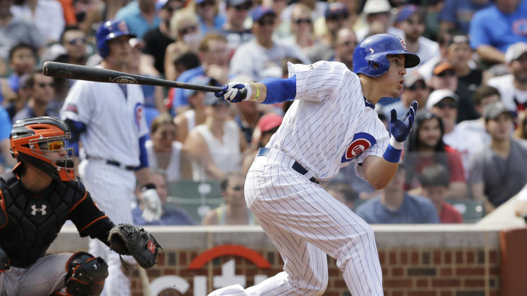 Chicago Cubs' Logan Watkins hits an RBI single during the fourth inning of an interleague baseball game against the Baltimore Orioles in Chicago, Friday, Aug. 22, 2014. (AP Photo/Nam Y. Huh)