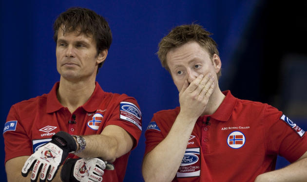 Norwegian skip Thomas Ulsrud (L) and third Torger Nergaard react to a missed shot in their 7-6 loss to Sweden in the bronze medal match at the Ford World Men's Curling Championships in Regina, Saskatc
