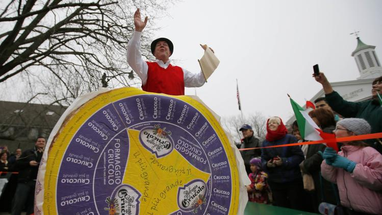 Peter Lovis, proprietor of the Concord Cheese Shop, announces the arrival of a 400-pound wheel of Crucolo cheese at his shop in Concord, Massachusetts