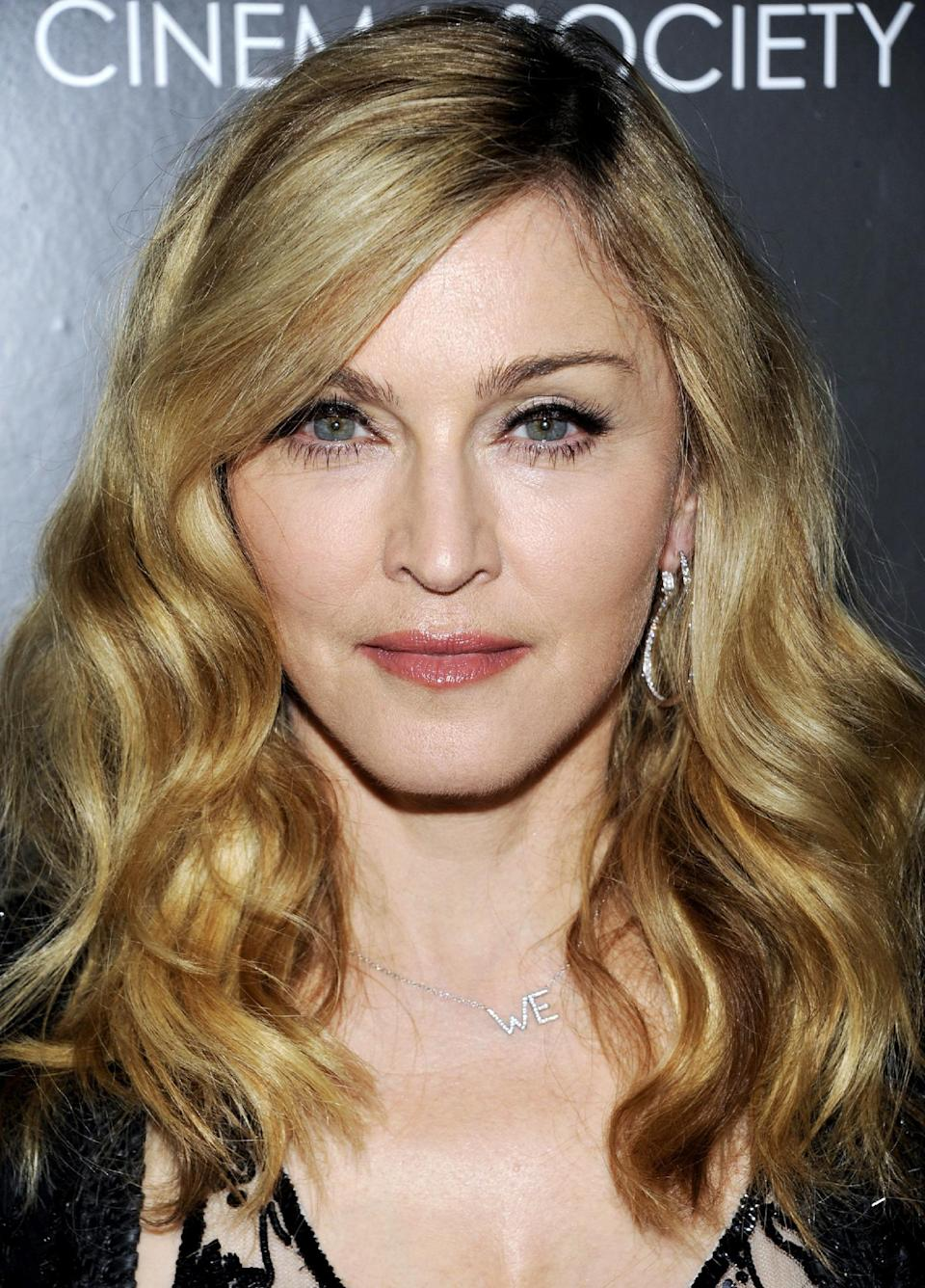 "Director Madonna attends a special screening of ""W.E."" at the Museum of Modern Art on Sunday, Dec. 4, 2011 in New York. (AP Photo/Evan Agostini)"