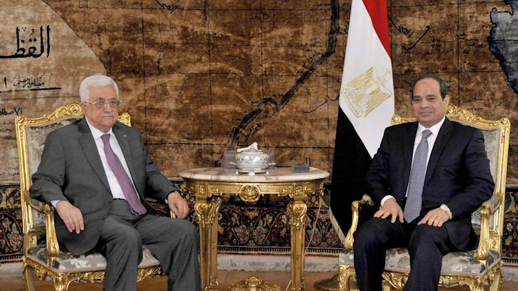 In this photo provided by Egypt's state news agency MENA, Egyptian President Abdel-Fattah el-Sissi, right, meets with Palestinian President Mahmoud Abbas in the presidential palace, Cairo Egypt, Saturday, Aug. 23, 2014. Egypt on Saturday called for an open-ended cease-fire in the Gaza Strip, urging the Palestinians and Israel to return to indirect talks. The call from the foreign ministry came shortly after Abbas met with el-Sissi in Cairo. (AP Photo/Ahmed Foad, MENA)