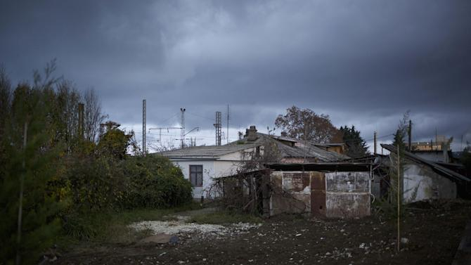 In this photo taken on Wednesday, Nov. 27, 2013, the 5a street Akatsiy's house is in the village of Vesyoloye outside Sochi, Russia. As the Winter Games are getting closer, many Sochi residents are complaining that their living conditions only got worse and that authorities are deaf to their grievances. (AP Photo/Alexander Zemlianichenko)