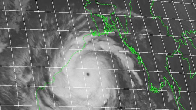 This photo provided by the U.S. Navy's Joint Typhoon Warning Center shows Cyclone Phailin taken at 7:30 p.m. EDT (11:30 p.m GMT) Friday Oct. 11, 2013. The U.S. Navy's Joint Typhoon Warning Center in Hawaii forecast maximum sustained winds of 269 kilometers (167 miles) per hour with gusts up to 315 kilometers (196 miles) per hour. (AP Photo/U.S. Navy Joint Typhoon Warning Center)