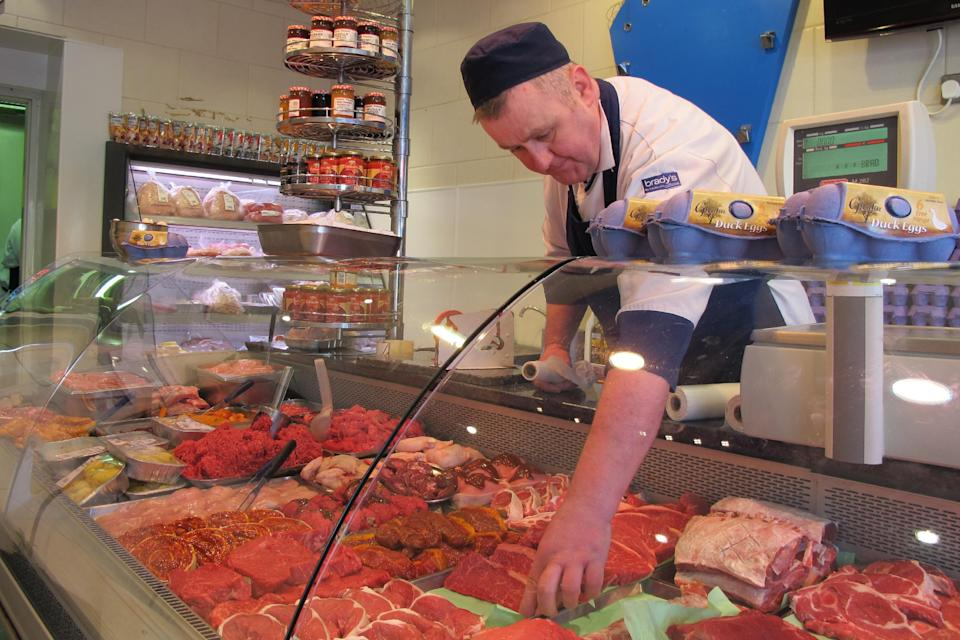Butcher Sean Smith, 43, arranges his display of premium Irish meats in his shop in Dublin on Thursday, Jan. 19, 2012. Smith says Ireland feels like it's ``under German rule'' ever since the country took an EU-led bailout. (AP Photo/Shawn Pogatchnik)