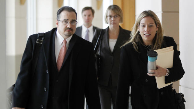 Public Defenders Mitch Ahnstedt, left, Ryan Loewer, Katherine Spengler and investigator Megan McKinlay, right, leave the courtroom after a hearing for Austin Reed Sigg, 17, the suspect in connection with the death of 10-year-old Jessica Ridgeway at the Jefferson County Courthouse in Golden, Colo., on Thursday, Oct. 25, 2012. Ridgeway disappeared Oct. 5 after leaving home for school. Her remains were found 5 days later. (AP Photo/Ed Andrieski)