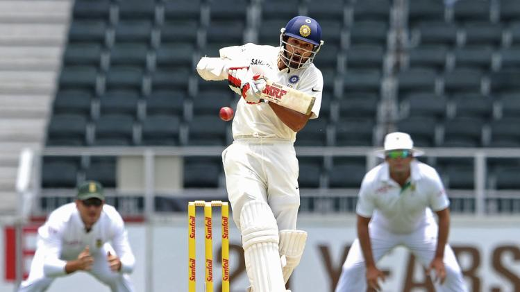 India's Dhawan plays a delivery from South Africa's Philander during the third day of their cricket test match in Johannesburg