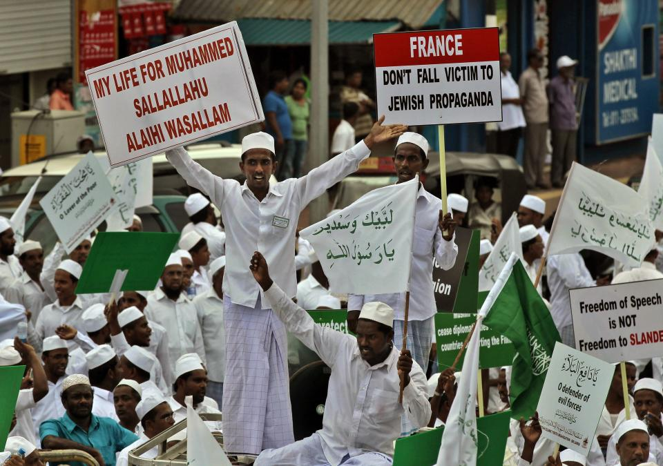 "Sri Lankan Muslims hold placards as they shout slogans during a protest outside the U.S. Embassy in Colombo, Sri Lanka, Monday, Sept. 24, 2012. Thousands of Sri Lankan Muslims protested against the American-produced film ""Innocence of Muslims"" that ridicules Islam's Prophet Muhammad. (AP Photo/Eranga Jayawardena)"