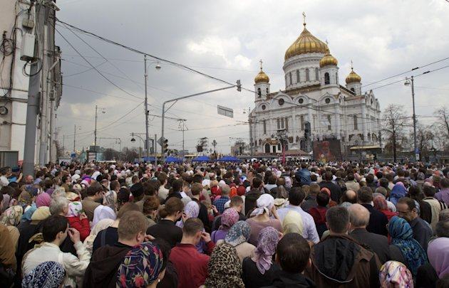 "Russian Orthodox belivers pray outside the Christ the Savior Cathedral in Moscow, Russia, Sunday, April 22, 2012. Thousands have gathered at Moscow's main cathedral to pray for the defense of the Russian Orthodox Church. Patriarch Kirill called on worshippers at Sunday's service to pray ""for our faith, our church, our sacred objects and our fatherland."" (AP Photo/Ivan Sekretarev)"