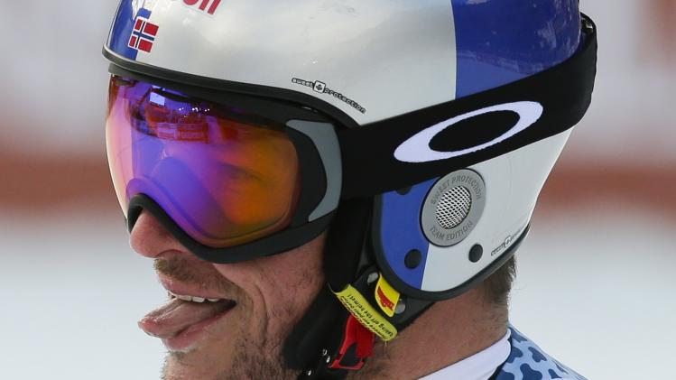 Svindal of Norway reacts after crossing the finish line during the men's World Cup Downhill skiing race in Val Gardena