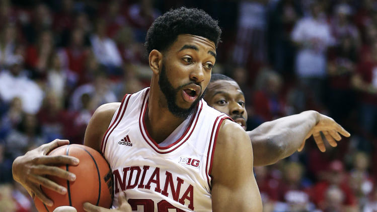 Indiana's Christian Watford grabs a rebound against Bryant's Alex Francis during the first half of an NCAA college basketball game, Friday, Nov. 9, 2012, in Bloomington, Ind. (AP Photo/Darron Cummings)