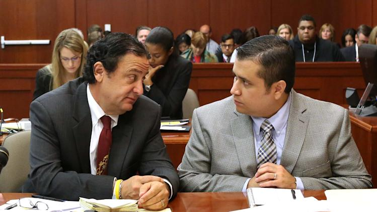 George Zimmerman, right, listens to jury consultant Robert Hirschhorn during Zimmerman's trial in Seminole circuit court in Sanford, Fla., Monday, June 17, 2013. Zimmerman has been charged with second-degree murder in the shooting death of Trayvon Martin. (AP Photo/Orlando Sentinel, Joe Burbank, Pool)