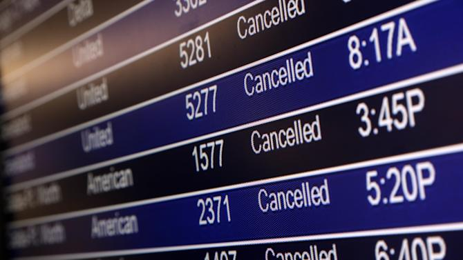 In this Sunday, Jan. 5, 2014, file photo, a departures board shows canceled flights at Lambert-St. Louis International Airport in St. Louis. A series of winter storms have led airlines to cancel more than 33,000 flights during the first three weeks of this year. That's more cancellations than in January 2013 and January 2012 combined, according to masFlight, a data and software company specializing in airline operations. (AP Photo/Jeff Roberson, File)
