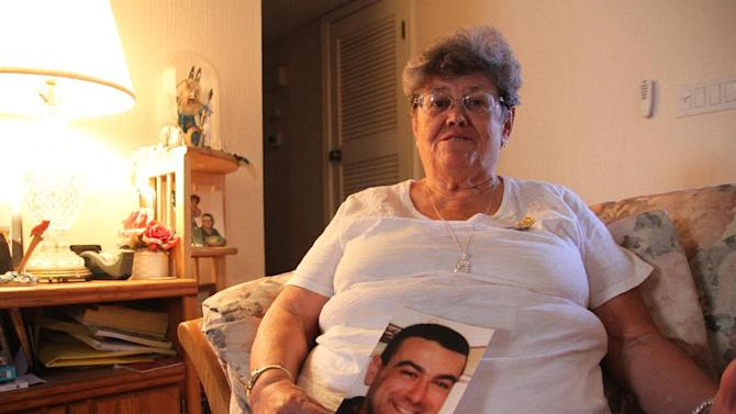 """Lillian """"Bonnie"""" D'Amico, poses for a photograph while holding a photo of her son Nicholas D'Amico in El Paso, Texas, Wednesday, June 11, 2014. Her son killed himself while waiting for a an appointment with a psychiatrist. Some Veterans Affairs facilities in Texas have among the longest wait-times in the nation for those trying to see a doctor for the first time, according to federal data released Monday. (AP Photo/Juan Carlos Llorca)"""