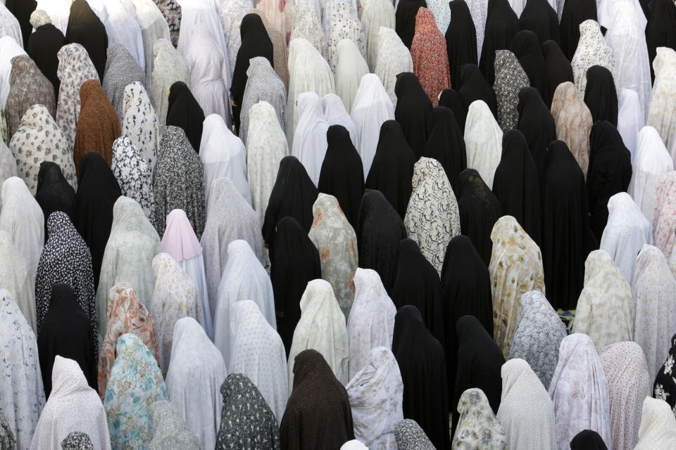 Female Iranian worshippers perform Eid al-Fitr prayer in Shahr-e-Ray, south of Tehran, Iran, Sunday, Aug. 19, 2012. Muslims around the world celebrate the Eid al-Fitr, the feast that marks the end of the holy month of Ramadan. (AP Photo/Vahid Salemi)