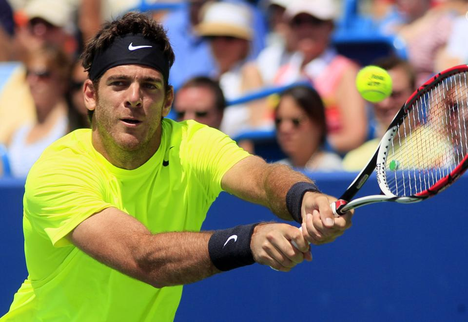 Juan Martin del Potro, from Argentina, returns a serve against Novak Djokovic, from Serbia, during a semifinal match at the Western & Southern Open tennis tournament, Saturday, Aug. 18, 2012, in Mason, Ohio. (AP Photo/Al Behrman)