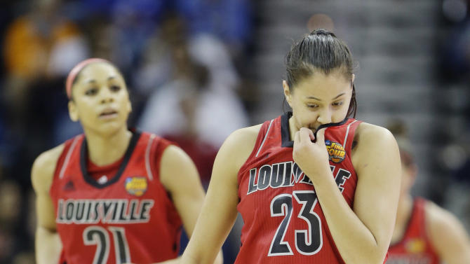 Louisville guard Shoni Schimmel (23) wipes her face during the second half of the national championship game against Connecticut at the women's Final Four of the NCAA college basketball tournament, Tuesday, April 9, 2013, in New Orleans. (AP Photo/Gerald Herbert)
