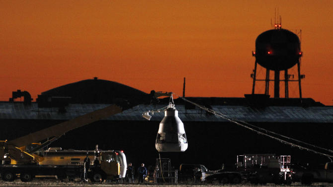 As the sun rises, workers prepare at the launch site, ahead of an attempt by Felix Baumgartner to break the speed of sound with his own body by jumping from a space capsule lifted by a helium balloon, Sunday, Oct. 14, 2012, in Roswell, N.M.  Baumgartner plans to jump from an altitude of 120,000 feet, an altitude chosen to enable him to achieve Mach 1 in free fall, which would deliver scientific data to the aerospace community about human survival from high altitudes.(AP Photo/Ross D. Franklin)