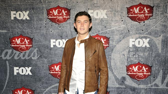 Singer Scotty McCreery arrives at the American Country Awards on Monday, Dec. 10, 2012, in Las Vegas. (Photo by Jeff Bottari/Invision/AP)