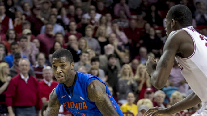 Florida's Kenny Boynton (1) drives to the basket against Arkansas' Jacorey Williams (22) during the first half an NCAA college basketball game in Fayetteville, Ark., Tuesday, Feb. 5, 2013. (AP Photo/Gareth Patterson)