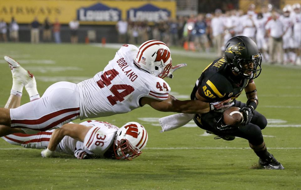 Wisconsin's Chris Borland (44) and Ethan Armstrong (36) are able to bring down Arizona State's Frederick Gammage short of the endzone in the first half of an NCAA college football game on Saturday, Sept. 14, 2013, in Phoenix. (AP Photo/Ross D. Franklin)