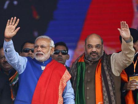 Indian PM Modi and Shah, the president of BJP, wave to their supporters during a campaign rally ahead of state assembly elections in New Delhi