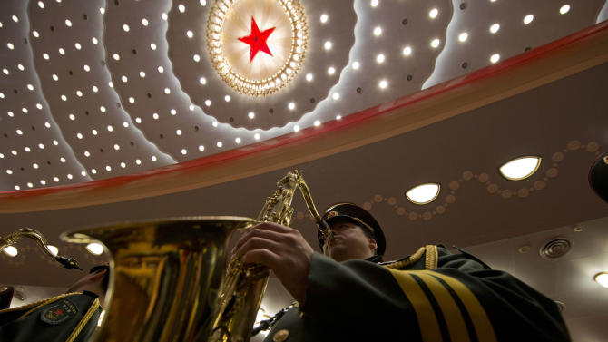 A Chinese military band member rehearses before the opening session of the 18th Communist Party Congress held at the Great Hall of the People in Beijing, China, Thursday, Nov. 8, 2012. (AP Photo/Ng Han Guan)