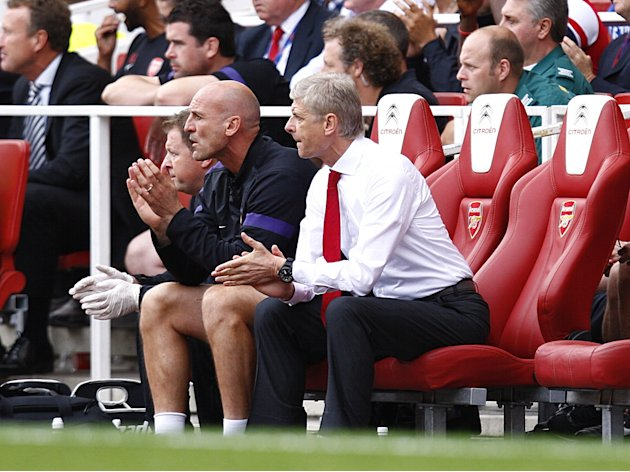 Arsene Wenger, right, has dismissed talk of a fall-out with Steve Bould