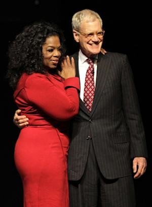 "FILE - This Nov. 26, 2012 file photo shows Ball State University alumnus David Letterman, right, host of CBS's ""Late Show,"" with Oprah Winfrey following an interview at Ball State University in Muncie, Ind. Letterman says he sees a psychiatrist once a week, part of his attempt to be the person he once believed he was. The late-night talk show host gave an extraordinary interview to Oprah Winfrey, where he talked about his feuds with her and Jay Leno and his own effort to make amends for the affairs that became public three years ago when a man tried to extort him.  (AP Photo/Michael Conroy, file)"