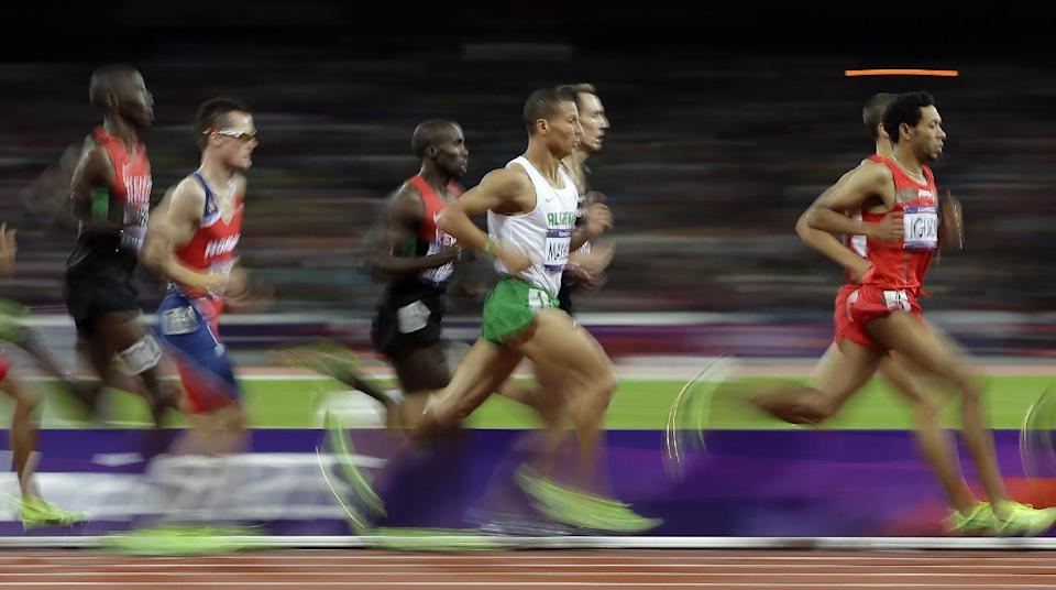 Taoufik Makhloufi of Algeria runs in the men's 1500-meter during the athletics in the Olympic Stadium at the 2012 Summer Olympics, London, Tuesday, Aug. 7, 2012. (AP Photo/Matt Slocum)