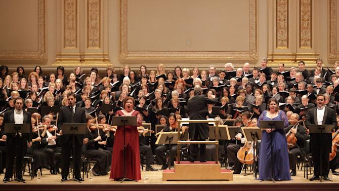 """In this  Dec. 5, 2012 photo provided by Carnegie Hall, soloists from left, Nicholas Houhoulis, Nicholas Pallesen, Jamie Barton, Angela Meade and Michael Spyres, perform Bellini's """"Beatrice di Tenda"""" at Carnegie Hall in New York. James Bagwell, center, conductors, the Collegiate Chorale and the American Symphony Orchestra in the seldom-performed work. (AP Photo/Carnegie Hall, Erin Baiano)"""