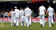 England players celebrate following during the first test at Lord&#39;s Cricket Ground, London