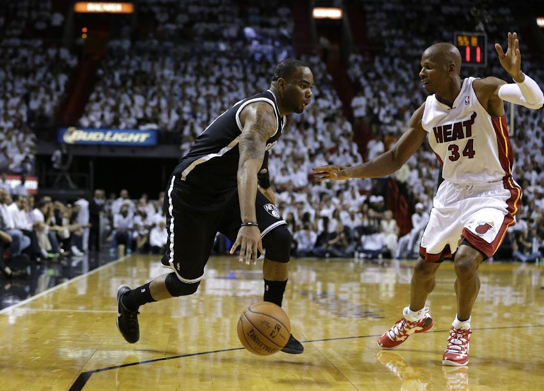 Brooklyn Nets' Marcus Thornton, left, drives to the basket as Miami Heat's Ray Allen (34) defends in the second half of Game 1 in an Eastern Conference semifinal basketball game, Tuesday, May 6, 2014, in Miami. The Heat defeated the Nets 107-86. (AP Photo/Lynne Sladky)