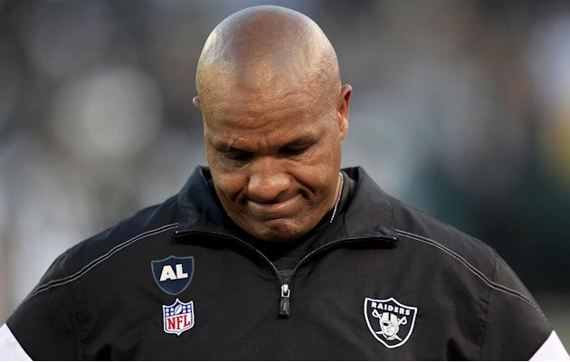 FILE - In this Jan. 1, 2012 file photo, Oakland Raiders head coach Hue Jackson looks down on the field during the fourth quarter of an NFL football game against the San Diego Chargers in Oakland, Cali