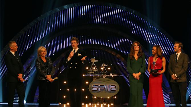 Winner of the Sports Personality of the Year 2012, Bradley Wiggins, center,  accepts his award onstage as Gary Lineker, left, Sue Barker, second from left, Kate, the Duchess of Cambridge, third from right, second place winner of the Sports Personality of the Year 2012, Jessica Ennis, second from right,  and David Beckham watch, during the BBC Sports Personality of the Year Awards 2012 in London, Sunday Dec. 16, 2012. (AP Photo/David Davies, PA) UNITED KINGDOM OUT: NO SALES: NO ARCHIVE