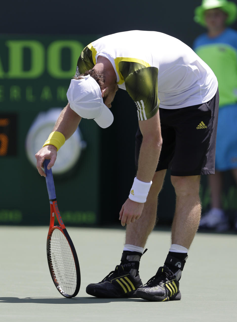 Andy Murray, of Great Britain, reacts during a match against David Ferrer, of Spain, during the final of the Sony Open tennis tournament  Sunday March 31, 2013, in Key Biscayne, Fla. (AP Photo/Wilfredo Lee)