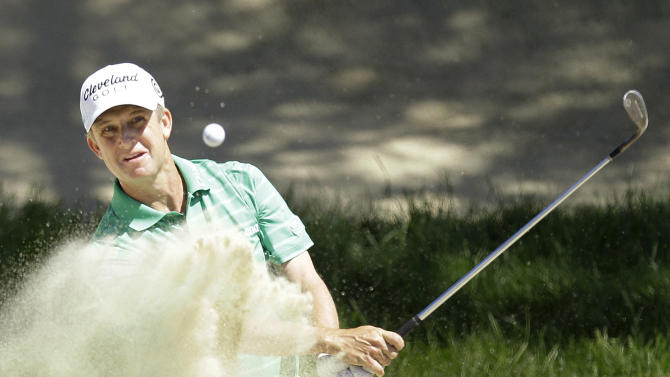 David Toms hits out of a bunker during the third round of the U.S. Open Championship golf tournament Saturday, June 16, 2012, at The Olympic Club in San Francisco. (AP Photo/Ben Margot)