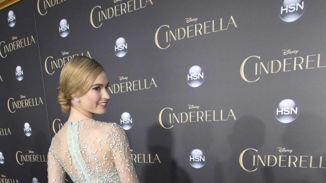 """Cast member Lily James poses at the premiere of """"Cinderella"""" at El Capitan theatre in Hollywood"""