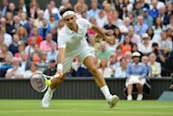 Switzerland's Roger Federer plays a vollwy during his men's singles final against Britain's Andy Murray at the Wimbledon Championships in Wimbledon, southwest London, on July 8. Federer won 4-6, 7-5, 6-3, 6-4