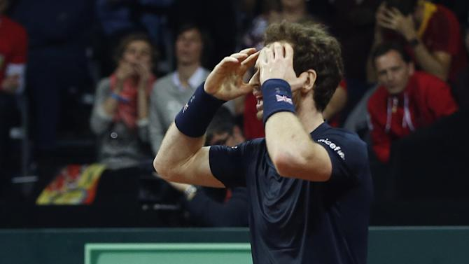 Britain's Andy Murray celebrates winning the Davis Cup after defeating Belgium's David Goffin in three sets, 6-3, 7-5, 6-3, during their singles Davis Cup final tennis match at the Flanders Expo in Ghent, Belgium, Sunday, Nov. 29, 2015. (AP Photo/Alastair Grant)