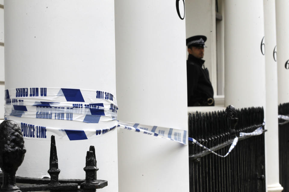 A police officer stands guard outside the home of Britain's richest women, American-born Eva Rausing who was found dead in her home in Belgravia, London, Wednesday, July 11, 2012. (AP Photo/Sang Tan)