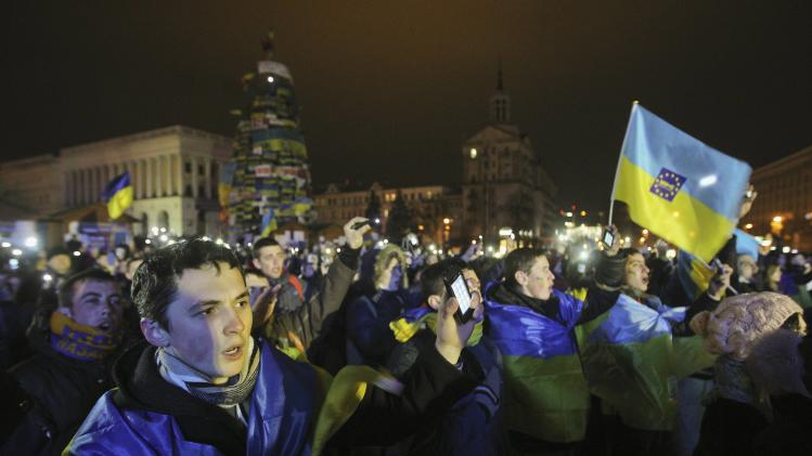 Supporters of Ukrainian EU integration shout slogans and wave flags during protest on Independence Square in Kiev
