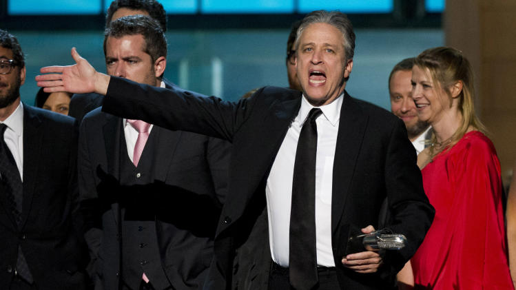 "In this April 28, 2012 photo, Jon Stewart from ""The Daily Show with Jon Stewart,"" appears onstage with his staff at The 2012 Comedy Awards in New York. The Comedy Awards will air on Sunday, May 6 at 9:00 p.m. EST on Comedy Central. (AP Photo/Charles Sykes, file)"