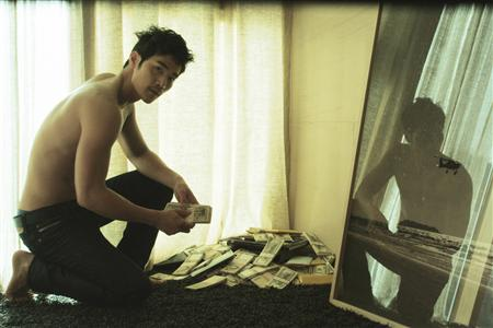 "Undated still photo of actor Kim Kang-woo in the movie ""Taste of Money"""