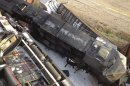 Two freight trains that collided at a rail intersection, collapsing an overpass in Missouri are pictured in this photo courtesy of KFVS12