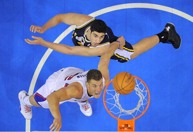 Los Angeles Clippers forward Blake Griffin, below, puts up a shot as Utah Jazz center Enes Kanter, of Turkey, defends during the second half of an NBA basketball game, Saturday, Feb. 1, 2014, in Los A