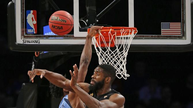 The FanDuel logo is visible, below, as Marquette guard Jajuan Johnson (23) defends Arizona State forward Obinna Oleka (5) during NCAA college basketball game in the FanDuel Legends Classic championship, Tuesday, Nov. 24, 2015, in New York. FanDuel and DraftKings are due back in a New York court Wednesday after the state attorney general filed papers seeking to stop the sites from operating, while the sites have argued operations are legal. (AP Photo/Kathy Willens)