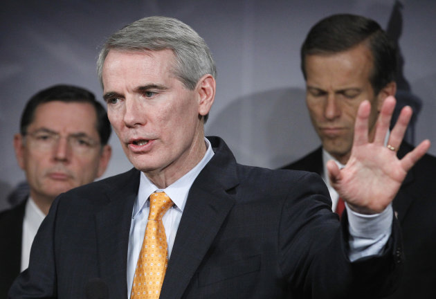 "Sen. Rob Portman, R-Ohio, center, with Sen. John Barrasso, R-Wyo, left, and Sen. John Thune, R-S.D. speaks during a news conference on Capitol Hill in Washington, Thursday, Nov. 3, 2011, to call for Senate action on the jobs bills, known as the ""Forgotten 15"" passed by the Republican-led House of Representatives. (AP Photo/Manuel Balce Ceneta)"
