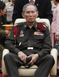 Thailand's King Bhumibol Adulyadej, pictured here in May, is revered as a demi-god by many Thais. He has been hospitalised since September 2009